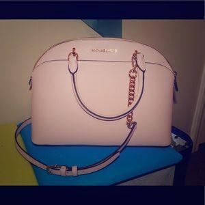 Michael Kors pale pink handbag.